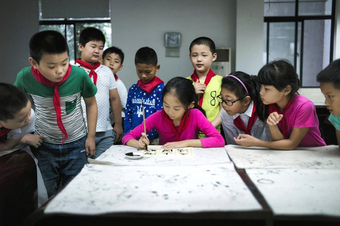 A young girl writes Chinese characters at an elementary school in Zhujiajiao, China, on Sept. 8.