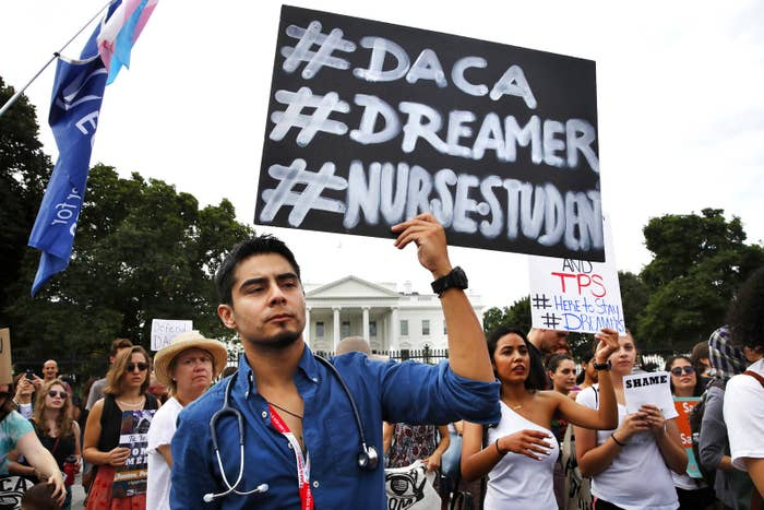 Carlos Esteban, 31, of Woodbridge, Virgina, a nursing student and recipient of DACA, rallies with others outside of the White House.