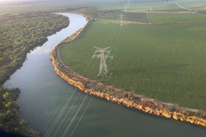 Electricity cables stretch over the Rio Grande from the United States into Mexico at the U.S.-Mexico border near McAllen, Texas.