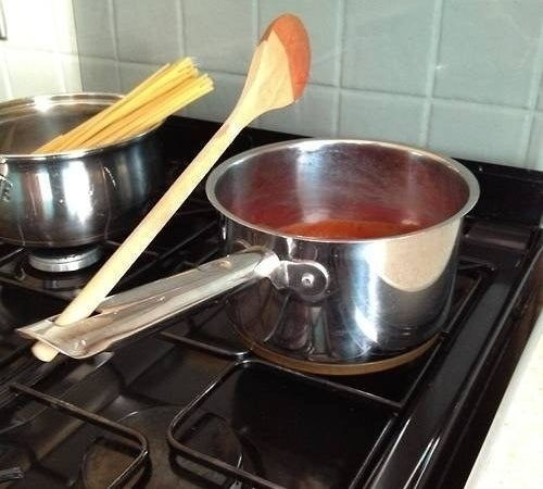 Again, it's multi-purpose: The original and most obvious use is for hanging your pots and pans when they're not in use. But you can also use the hole to hold onto a saucy spoon while you're cooking.