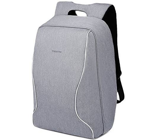 a820701b3a1f An anti-theft backpack perfect for travelers and commuters. I dare you to  find the zipper — or even a visible pocket.