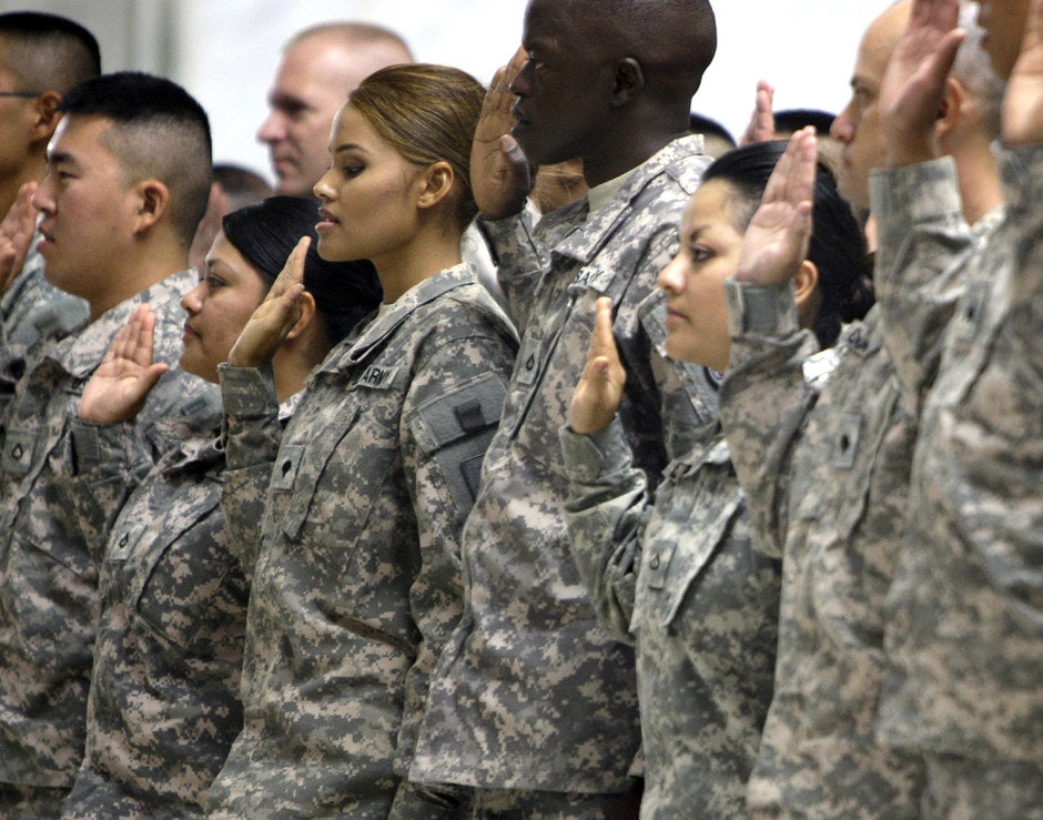 US soldiers taking their citizenship oath in 2010 at Camp Victory in Baghdad. A popular Pentagon program to reward immigrant recruits with citizenship has ground to a halt.