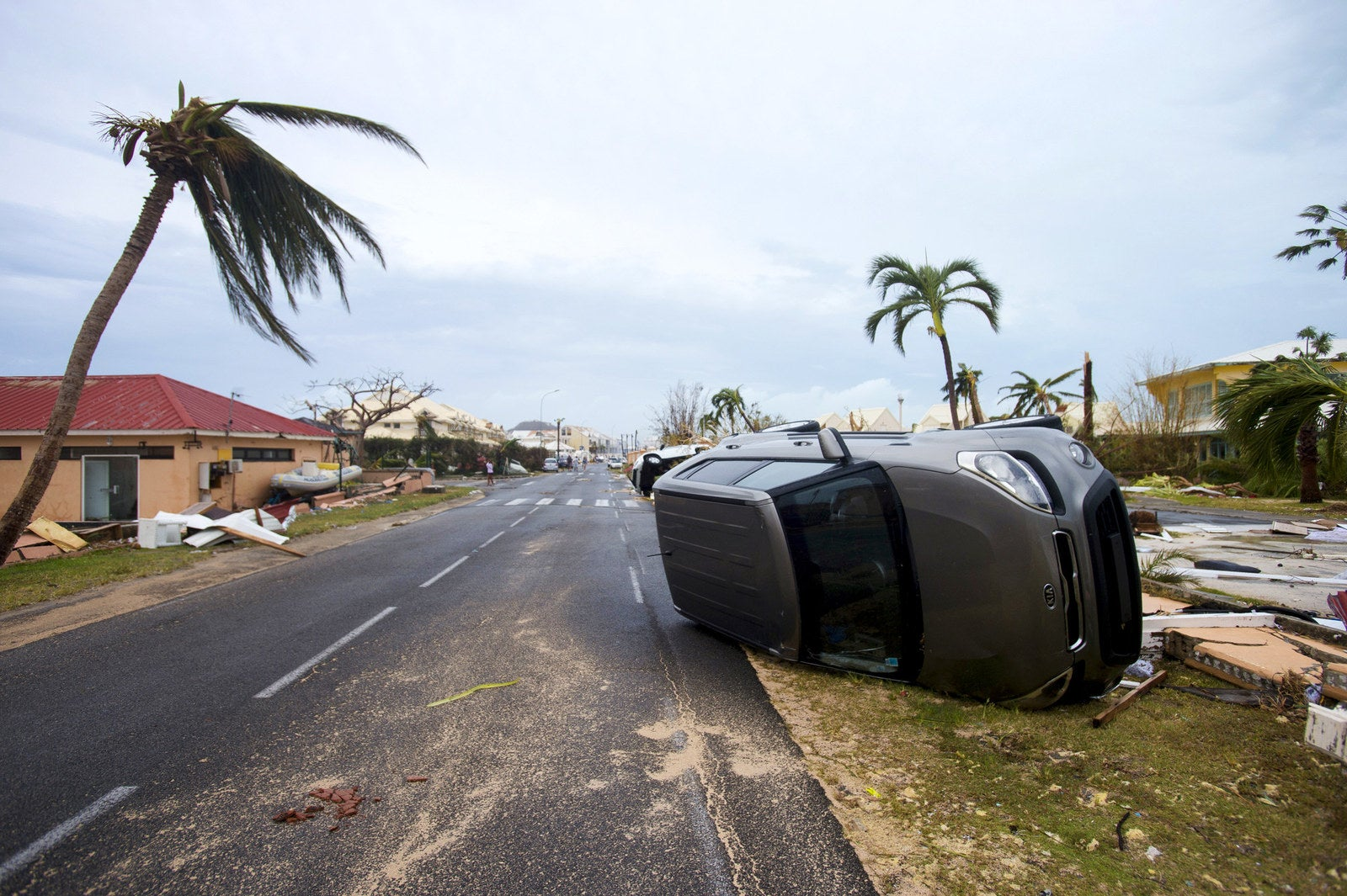 A car is left turned onto its side from hurricane winds in Marigot, Saint Martin, on Wednesday.