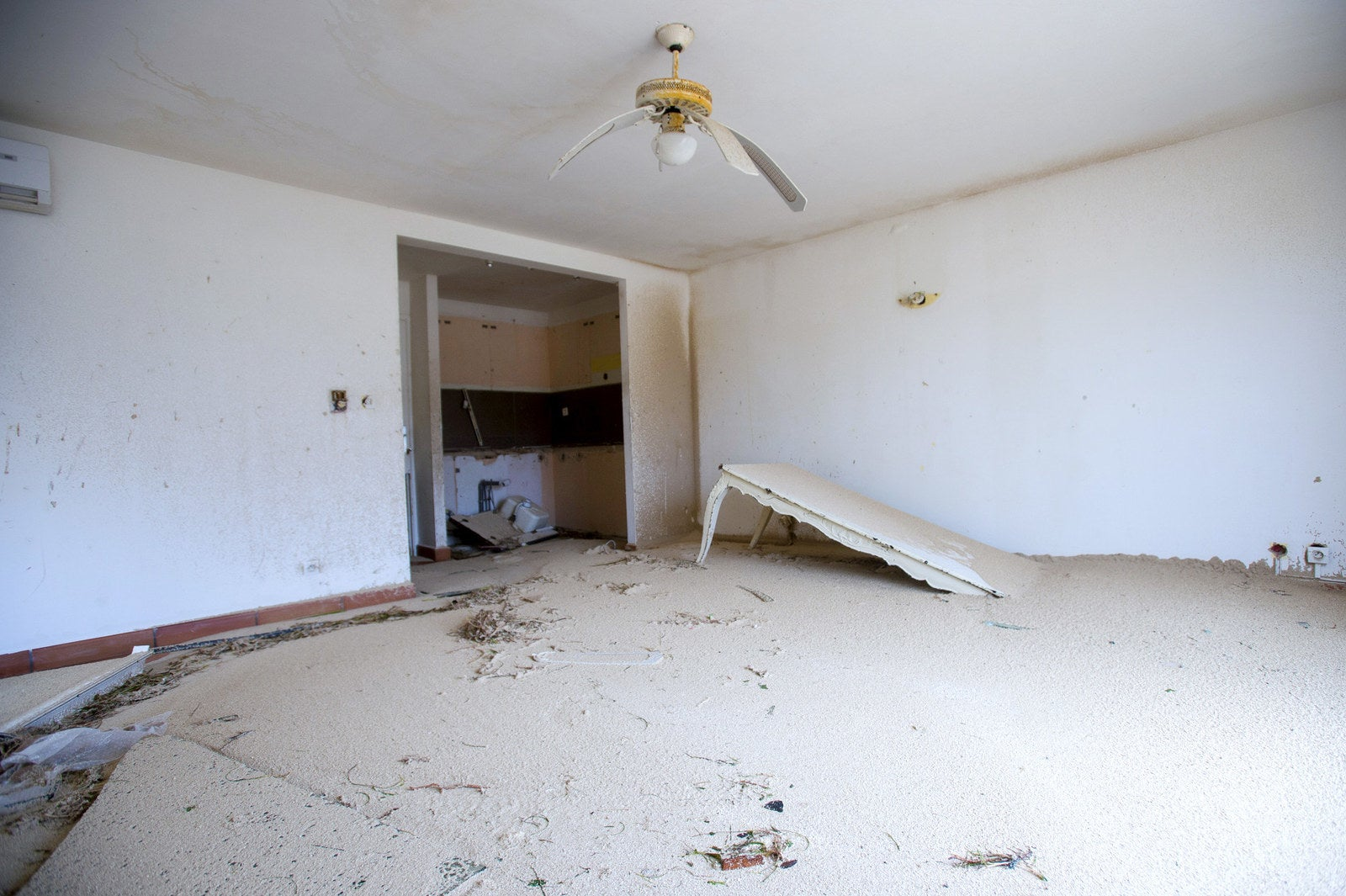 The interior of a home in Marigot, Saint Martin, is left filled with sand following the passage of Hurricane Irma.