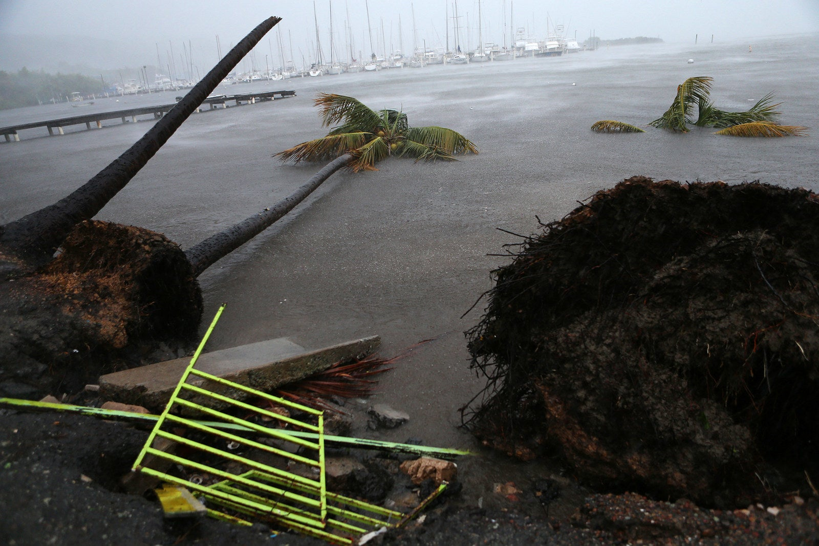 Debris is seen during a storm surge near the Puerto Chico Harbor in Fajardo, Puerto Rico.