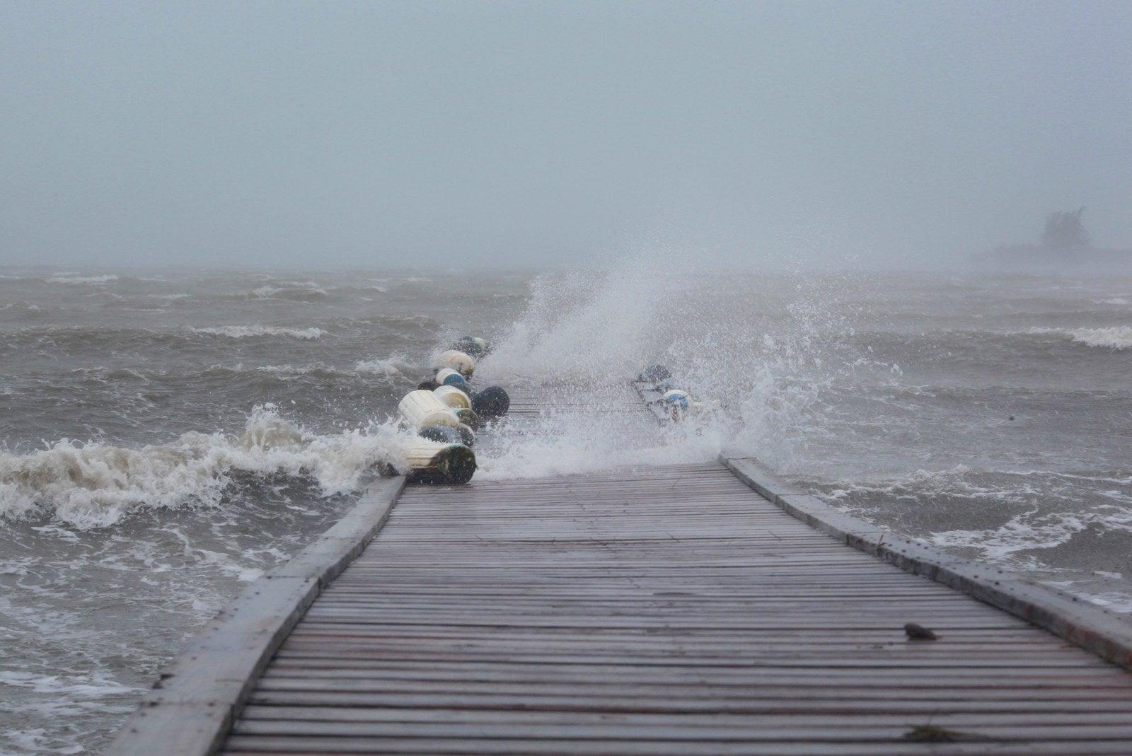 Waves break over a dock as Hurricane Irma slammed across islands in the northern Caribbean, in Fajardo, Puerto Rico, on Wednesday.