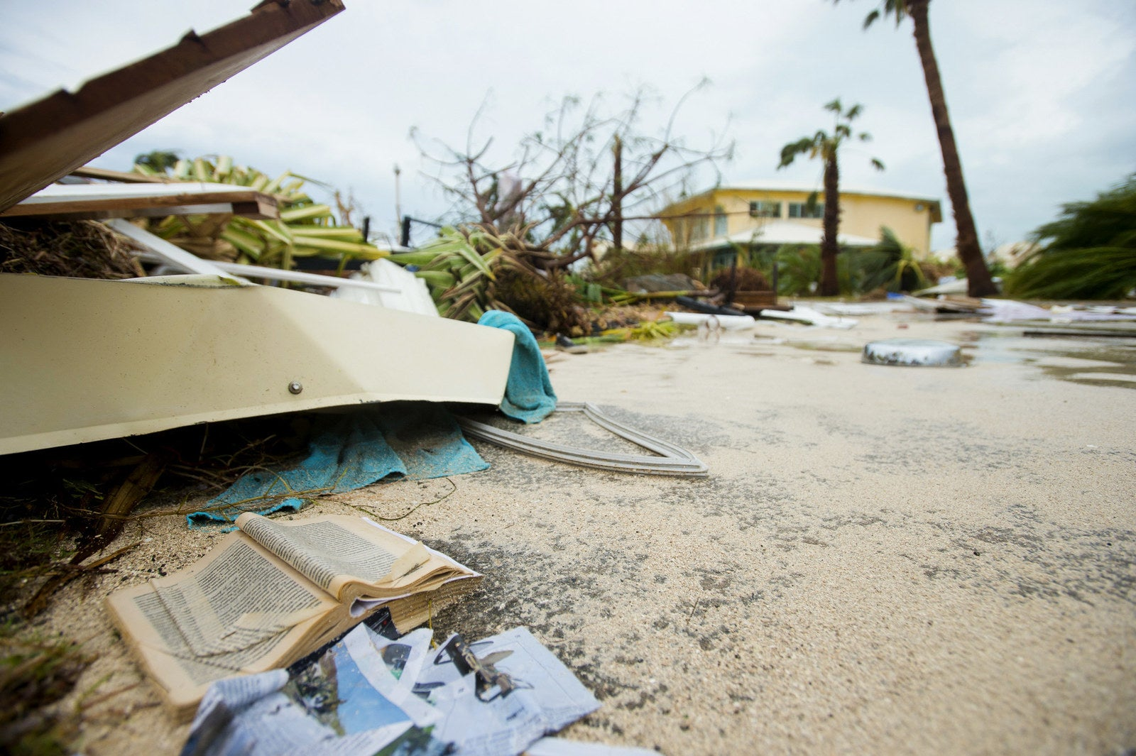 Damaged books and debris is sprawled throughout the streets of Marigot, Saint Martin.