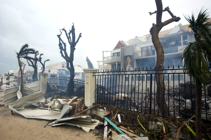 Smoke rises from a fire amid debris and damaged buildings in Marigot, near the Bay of Nettle, on the French island of Saint Martin on Wednesday.