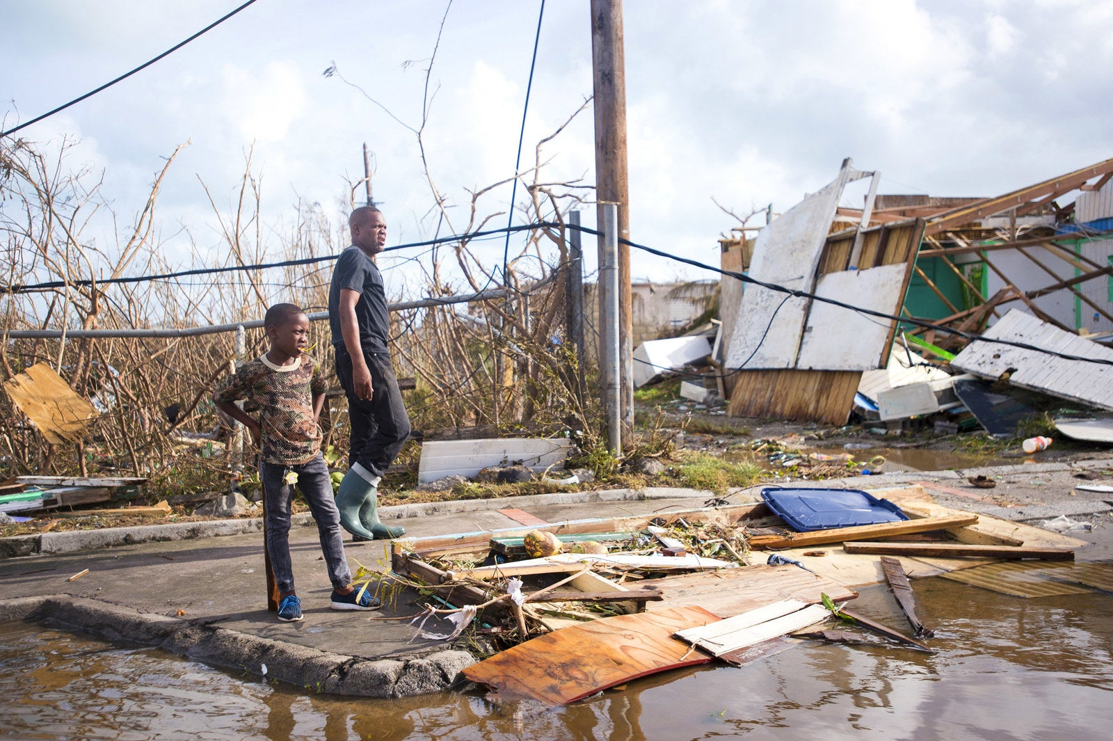 People inspect the damage in Marigot, Saint-Martin.