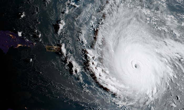 Hurricane Irma, a potentially catastrophic Category 4 hurricane, moves westward on Sept. 5 in the Atlantic Ocean toward the Leeward Islands. This image was captured at the beginning of daylight in the area, with nighttime visible to the left.