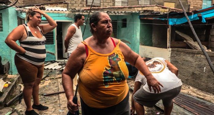 Residents return home in a town east of Havana.