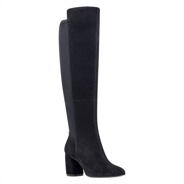 f299aa3dae2 A pair of suede wide-calf boots designed specifically for the girl who can  never find a pair of boots that actually fit!
