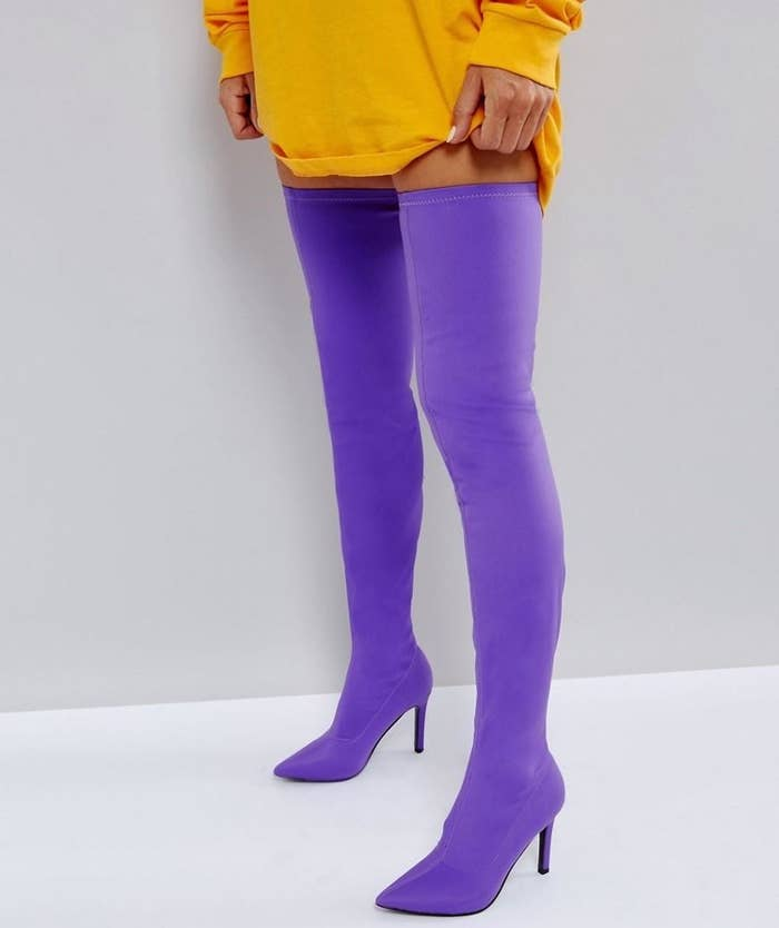 f09ab2aa1eb4 A gorgeous pair of purple stretch over-the-knee boots made with just enough  wow factor to make everyone stop and take notice.