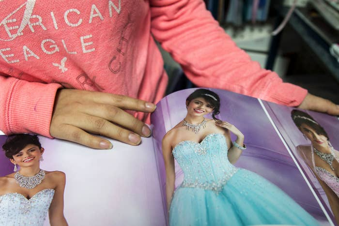 Miriam Morales points out her quinceañera dress in a catalog in Bushwick, Brooklyn, in December 2013.