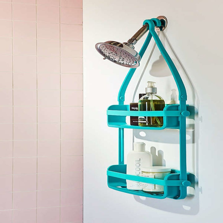 two tier shelf with bendy arms that come together to hang onto shower head