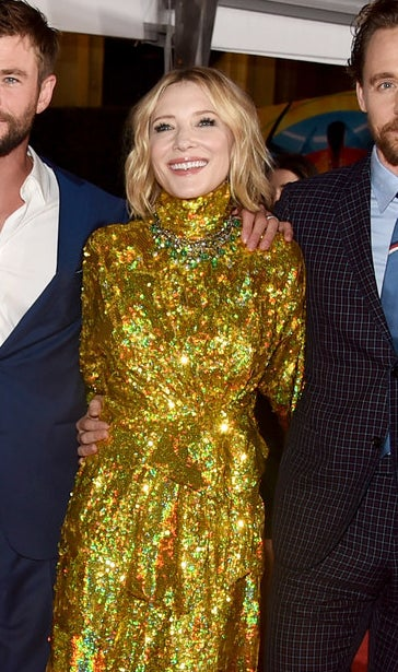 Cate Blanchett smiling with teeth.