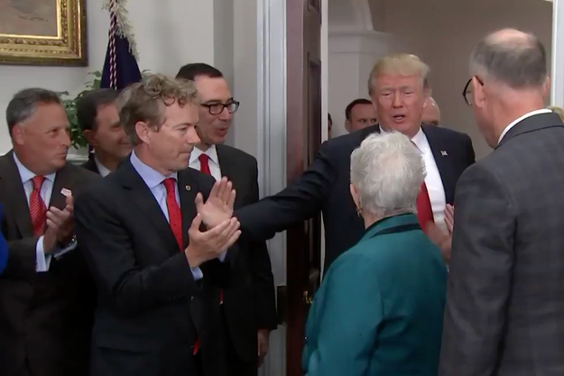 Trump moves to pat Paul on the shoulder, who leans away ever so slightly.