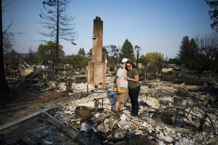 Nick Belliveau comforts his wife Alyssa after their home was completely destroyed by wildfire.