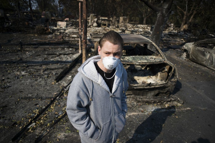 Bryan Heric surveys the damage after his home was completely destroyed by wildfire.