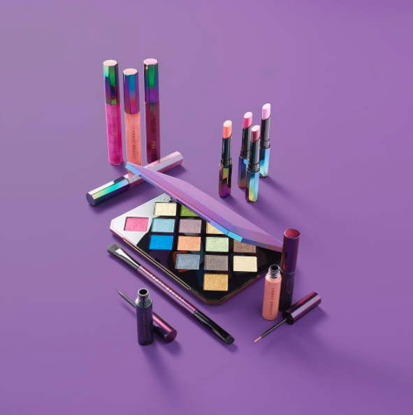 The latest release is called the Galaxy Collection and it includes the Galaxy Eyeshadow Palette, Starlit Hyper-Glitz Lipstick, Cosmic Gloss Lip Glitter, Eclipse 2-In-1 Glitter Release Eyeliner, and the special 2-Way Eyeshadow Brush.