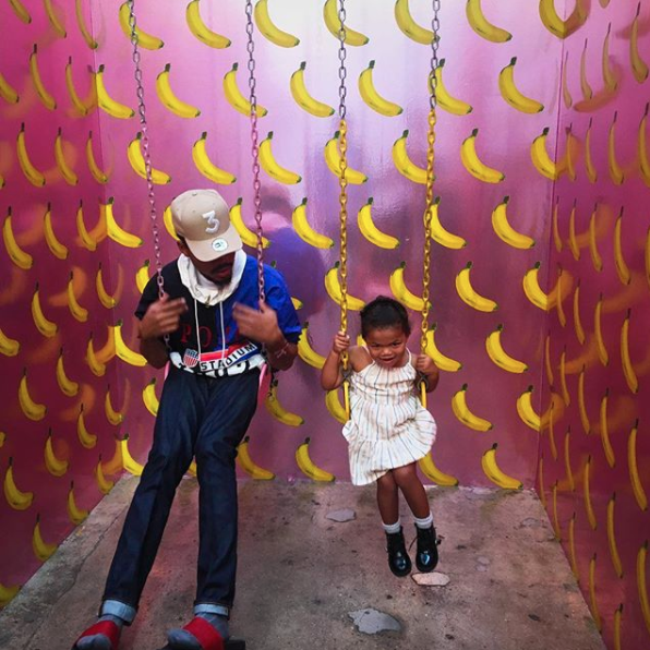 Chance The Rapper and his daughter were cute on swings.