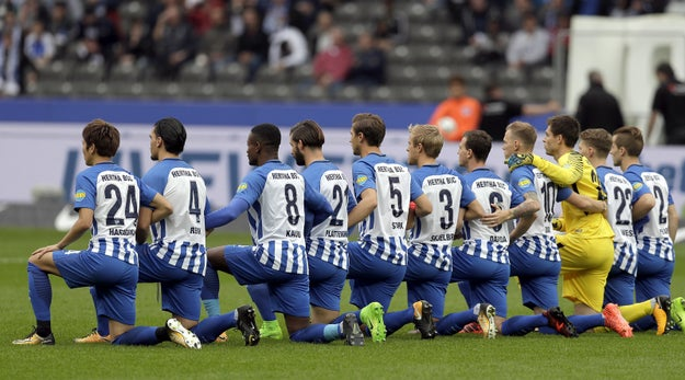 The team did not kneel during the German national anthem, as some reports said. The German national anthem is not traditionally played at German sporting events.