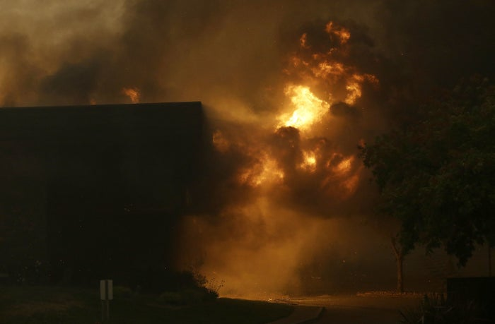 Smoke and fire rise from the Fountaingrove Inn as it burns in Santa Rosa, California, on Monday, Oct. 9.