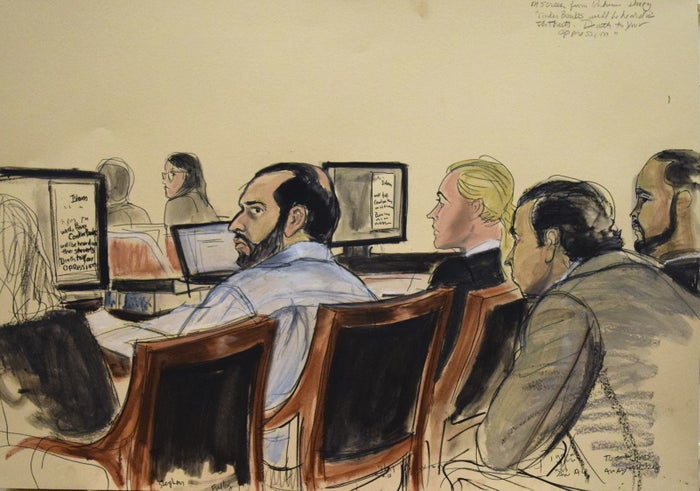 This courtroom sketch provided by artist Elizabeth Williams shows defendant Ahmad Khan Rahimi, seated, left, in court during opening arguments on the first day of his federal trial Monday, Oct. 2, 2017, in New York.