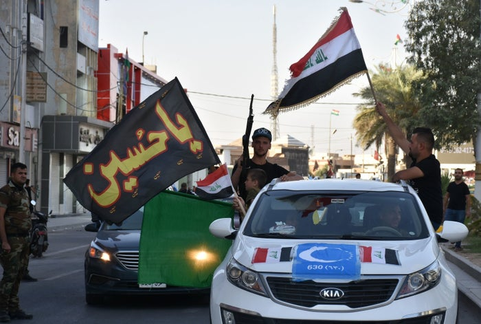 People celebrated after Iraqi forces advanced into Kirkuk.
