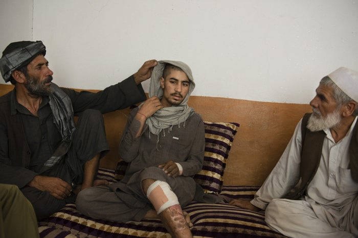 Shir-Agha Mohamed with his younger son, Zazai, who was badly injured in an airstrike.