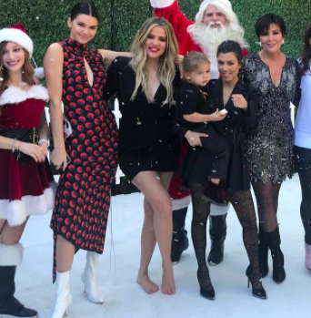 But the photo raises other questions, too, like, why is Khloé the only one who's barefoot?