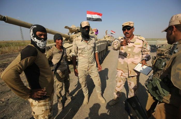 Iraqi forces discuss military tactics as they drive toward Kurdish peshmerga positions on the southern outskirts of Kirkuk on Oct. 15, 2017.