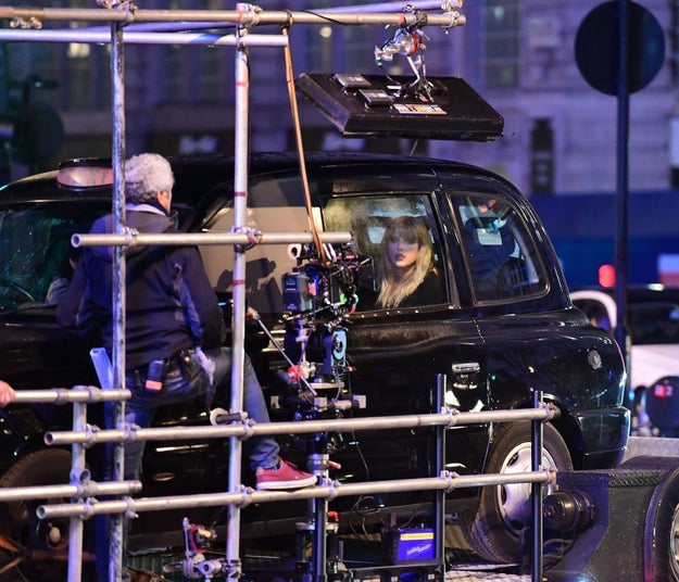 Here she is chillin' in the back of a black cab: