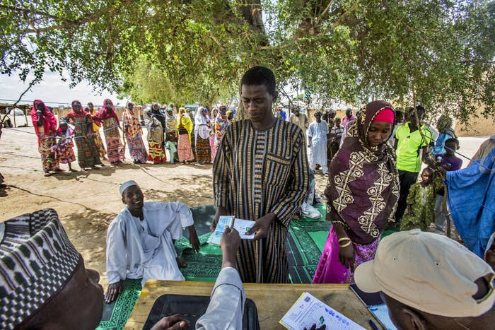 Habu Adamu, 37, collects his monthly stipend from an NGO at the informal internally displaced persons camp in Diffa, Niger.