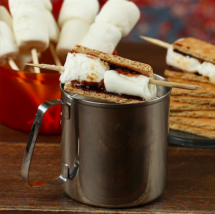Servings: 1Materials1 cup milk or alternative (warm or cold)4 ounces Irish cream whiskey1 bamboo sticks2 marshmallows2 graham crackersChocolate syrupInstructions1. Mix milk and Irish cream together by stirring.2. Put chocolate syrup on both sides of the graham crackers.3. Stick bamboo sticks through marshmallows.4. Roast marshmallows over fire.5. Put roasted marshmallows in between the graham crackers. Do not remove bamboo stick.6. Garnish cocktail with s'mores.