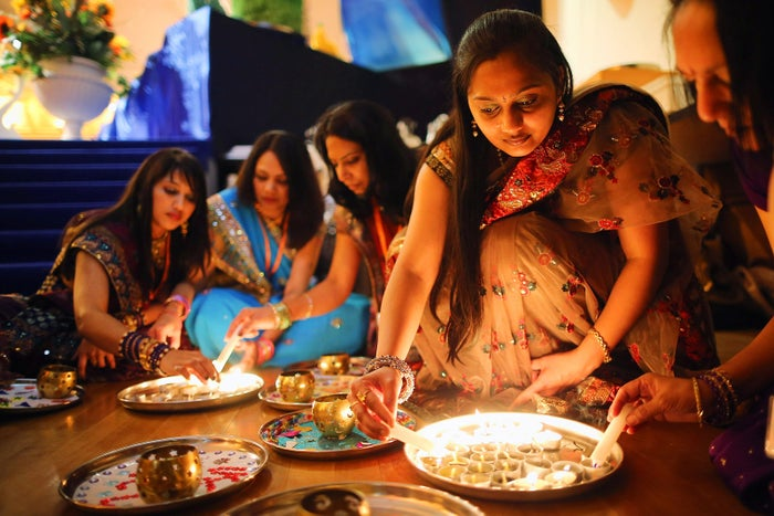 Scented candles are lit before being offered to well wishers during a ceremony to celebrate Diwali at the BAPS Shri Swaminarayan Mandir in London on Nov. 14, 2012. Diwali is one of the most important Hindu festivals dedicated to the Goddess of wealth, Laxmi.