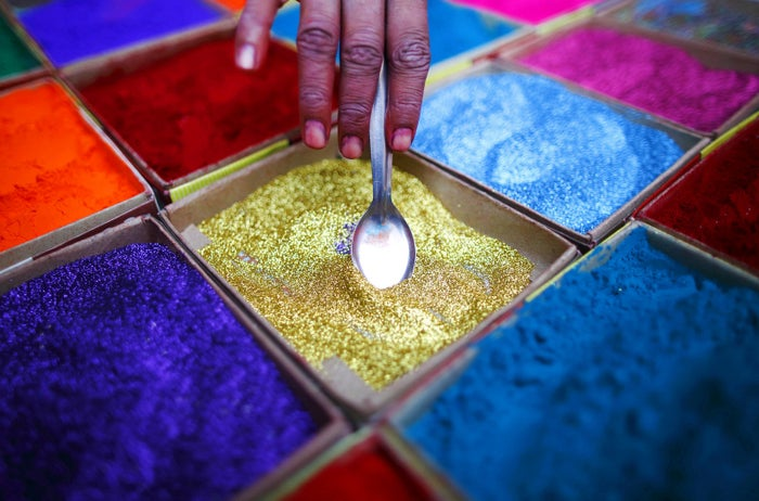 A street vendor spreads vermilion powder used for worship during the Diwali festival in Kathmandu, Nepal, on Oct. 20, 2014.
