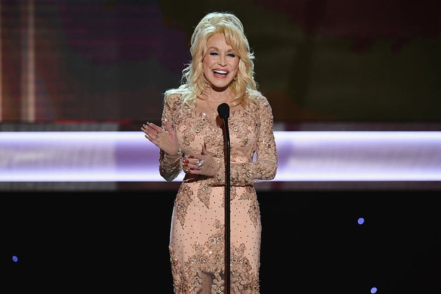 Also—and you may want to sit down for this—DOLLY PARTON IS WRITING NEW, ORIGINAL MUSIC FOR THE FILM.