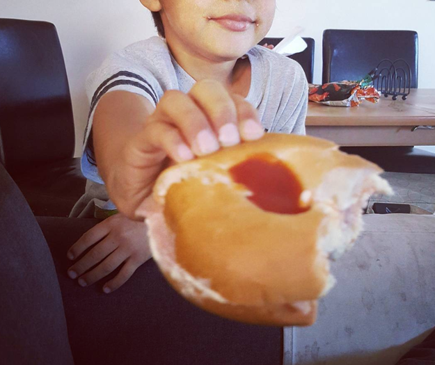 This kid who likes a little ketchup filling in his bagel.