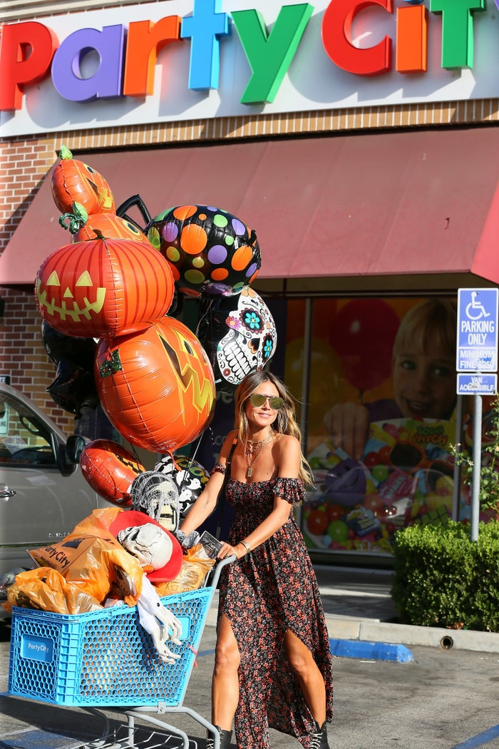 Heidi stocking up on Halloween decorations in EARLY September at Party City — such a humble Queen of Halloween.