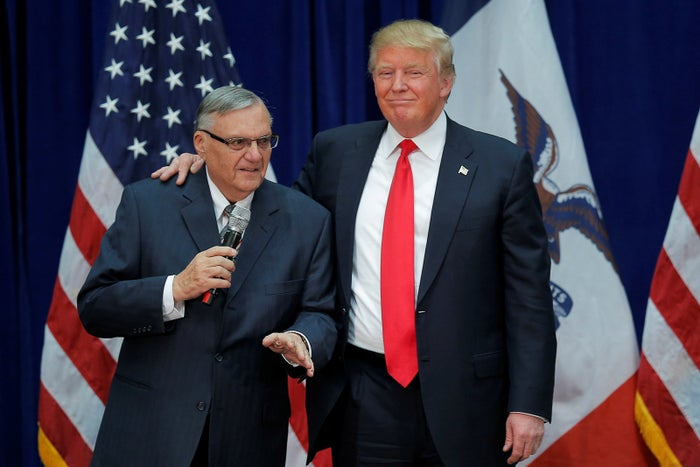 Then-candidate Donald Trump is joined onstage by then-Maricopa County Sheriff Joe Arpaio at a campaign rally in Iowa on January 26, 2016.