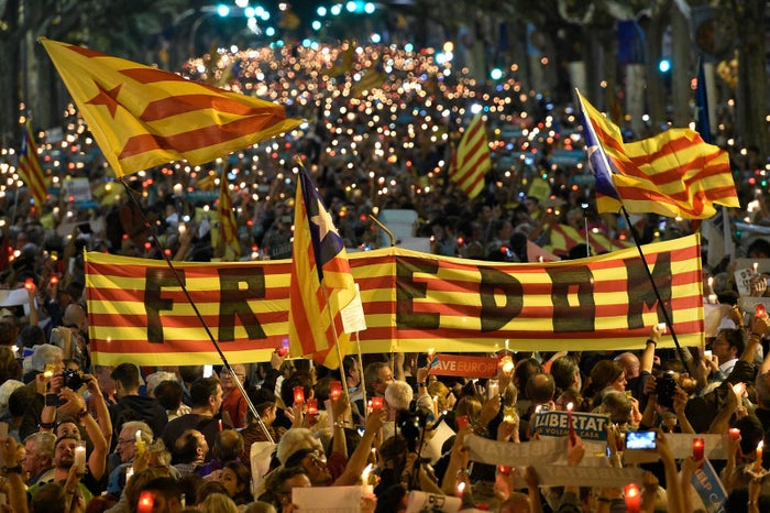 People attend a candle-lit demonstration in Barcelona against the arrest of two Catalan separatist leaders on October 17.