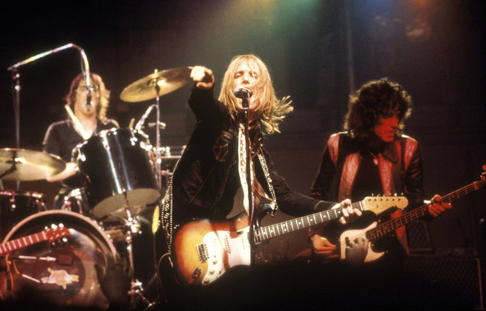 Tom Petty and the Heartbreakers perform live onstage in England in 1977.
