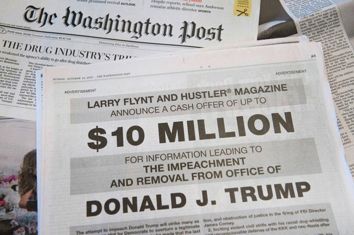 A full-page newspaper advertisement in the Washington Post offers $10 million from Hustler magazine publisher Larry Flynt for information leading to the impeachment and removal from office of US President Donald Trump, on Oct. 15 in Washington, DC.