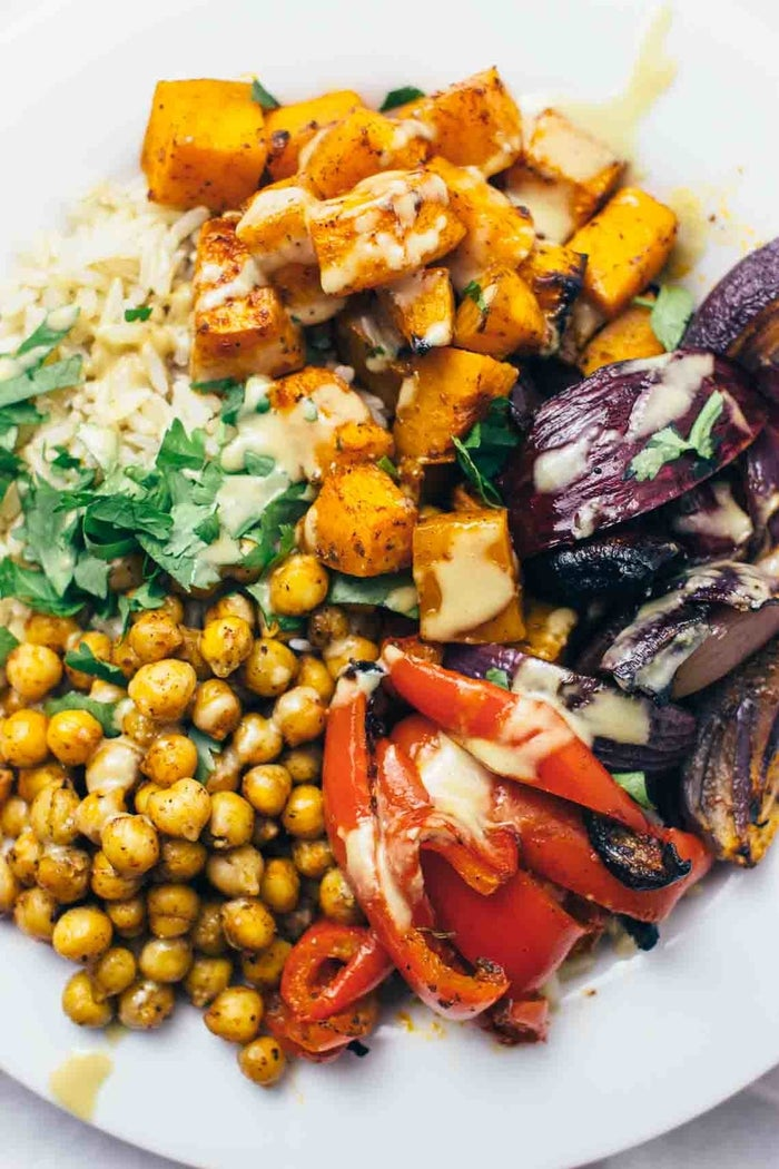 Roast your favorite veggies such as butternut squash, onions, and peppers with a drizzle of harissa, red wine vinegar, and olive oil. You may never want to eat vegetables any other way. Get the recipe.