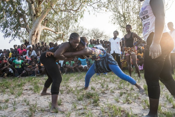 Girls and young women wait their turns to wrestle at the Festival of the King of Oussouye, where they can compete in traditional wrestling alongside the men.