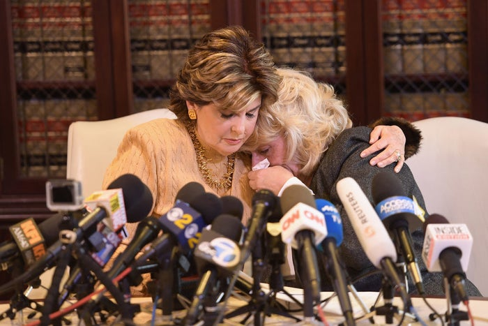 Attorney Gloria Allred (left) consoles her client, Heather Kerr, Oct. 20, 2017.