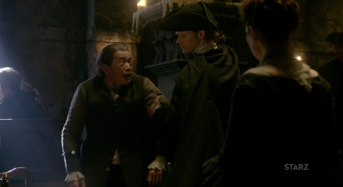 Gary Young as Yi Tien Cho (left) and Sam Heughan as Jamie Fraser in Outlander.
