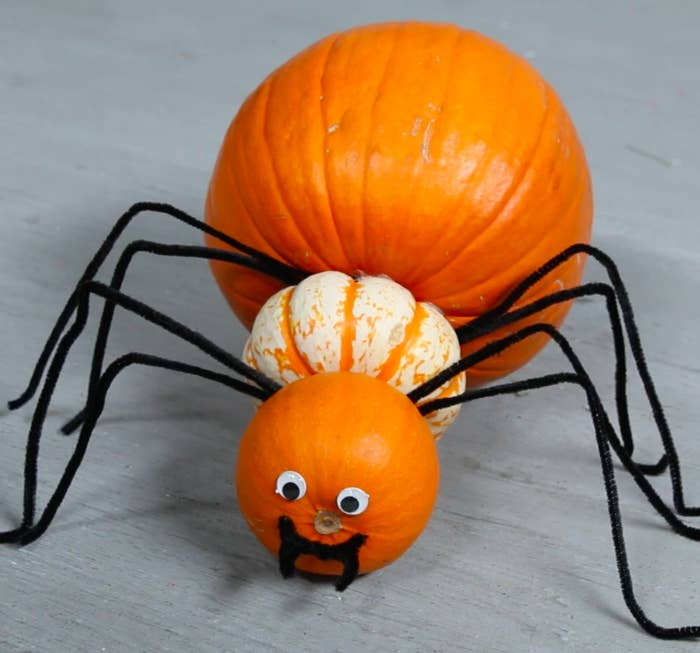 """MATERIALS1 large pumpkin1 medium pumpkin1 small pumpkin2 toothpicks9 pipe cleaners2 googly eyesStaplerGlueINSTRUCTIONS1. Bend pipe cleaners into the shape of a spider's leg.2. Staple four """"legs"""" to the bottom of the large pumpkin. 3. Stick a toothpick into the large pumpkin and put a ring of glue around it. Push the medium pumpkin onto the toothpick. 4. Repeat steps two and three with a smaller pumpkin.5. Stick googly eyes above the stem.6. Cut a pipe cleaner into a smile with fangs and glue."""