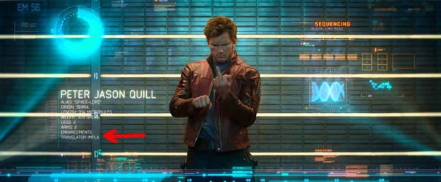 During this scene in Guardians of the Galaxy, a translator implant is listed as an enhancement under Peter Quill's profile. This would explain why he's able to communicate with every alien in the universe.